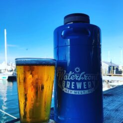 key west waterfront brewery growler mini keg in blue with beer in pint glass
